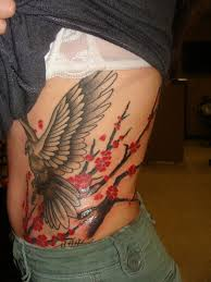 Realistic Black And Red Color Ink Asian Bird Blossoms Tattoo On Rib Side For Girls