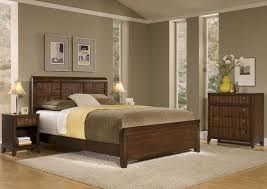 Simple Brown Wooden Bed With Head Board And Combinated Color Linen Also
