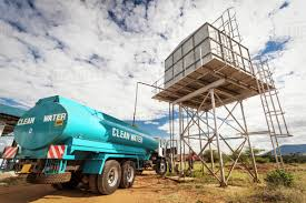 A Clean Water Truck Sits Below A Water Storage Tank; Kenya - Stock ... Water Tank Truck For Hire Junk Mail 2007 Powerstar 2635 18000l Water Tanker Truck For Sale 2017 Peterbilt 348 Tank Truck For Sale 7866 Miles Morris China 3000 Liters Dofeng 4x2 Mobile High Capacity Water Cannon Monitor On Custom Unsecured Flies Off Pickup Knocks Motorcyclist 2000 Gallon Ledwell North Benz Ng80 6x4 Power Star 20 Ton Wwwiben 100liter Manufactur100liter 20m3 Howo Cimc Foton Shacman Wwwscalemolsde Cat Dump 785d With Mega Mwt30