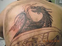 26 Fierce Dragon Tattoos For 2013