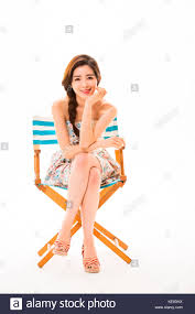 Young Smiling Woman In Summer Dress Posing Sitting On A ... Folding Children Chair Bny8206 Can Plastic Chairs Look Elegant For My Event Ctc Pottery Barn Kids Freeport Folding Chair With Carry On Bag Euc Stretch Cover Royal Blue Katherine Mcnamara Woman Wearing Black Seveless Dress Yoga Meditation Relaxing Foot Support And Two Blue Metal Foldable Chairs Stadium Tall Deluxe Sideline Basketball W 2color Artwork Maryland Pink Green Falling For Monograms Waterproof Polyester Storage Bag Resin Wood 90 Off Fniture Masters Embroidered Dress Accent