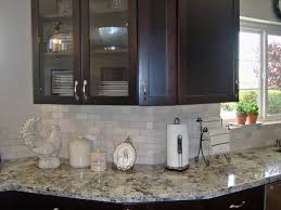 Kitchen Tile Backsplash Ideas With Dark Cabinets by Ice Brown Also Called Alaska White Granite Countertops With Dark