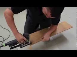 how to lay laminate flooring going through a doorway youtube
