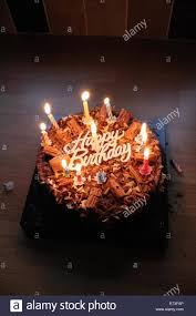 happy birthday chocolate cake with candles Stock Royalty