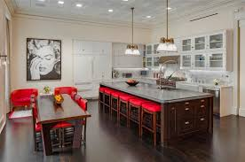 unique kitchen island with bar stools and polished brass pendant