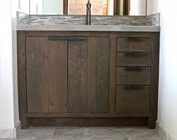 Dark Brown Wooden Bathroom Vanity With Grey Top And Sink On Floor