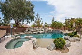 inimitable pool tile in las vegas with river rock pool waterfalls