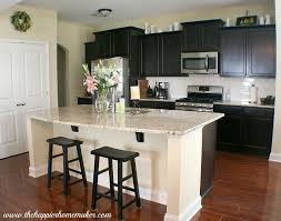 Espresso Kitchen Cabinets With Cherrywood Floor And Lighter Granite Countertops