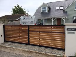 Modern Sliding Gate Designed To Look Like A Standard Double ... Sliding Wood Gate Hdware Tags Metal Sliding Gate Rolling Design Jacopobaglio And Fence Automatic Front Operators For Of And Domestic Gates Ipirations 40 Creative Gate Ideas 2017 Amazing Home Part1 Smart Electric Driveway Collection Installing Exterior Black Wrought Iron With Openers System Integration Contractors Fencing Panels Pedestrian Also