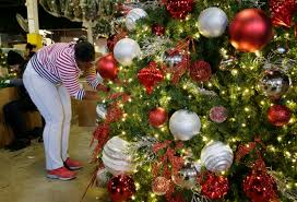 Tanisha Heyward Puts The Finishing Touches On A Large Christmas Tree At American Warehouse In Mount Vernon NY Thursday Nov 9 2017