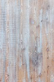 Aged Wooden Background Of Weathered Distressed Rustic Wood Boards With Faded Light Blue Paint Showing Brown