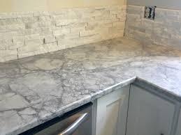 This Bathroom Cement Tile Floor Is In Progress In Corpus Christi by Arctic White Ledgestone And Super Fantasy White Granite Kitchen
