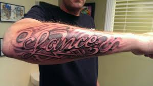 Amazing Lance Name Tattoo On Man Right Forearm