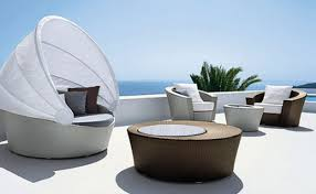 Wicker Sofa Bed And Square Cushions Facing Round Table As Modern Outdoor Furniture