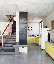 Offset By A Shade Of Canary Yellow The Concrete Floors In Kitchen This