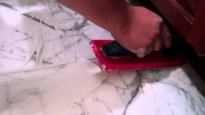 Regrout Old Tile Floor by How To Regrouting A Marble Foor Applying The Grout Youtube