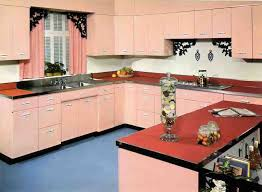 Vintage 50s Kitchen Decor With Pink Wooden Cabinet And Black Floral Detailed Backsplash Also L Shaped Orange Countertop Plus Small Cooktop