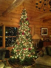 Beautiful Christmas Mountain Log Cabins Using Decorative Pine Trees Indoors Alongside Single Hung Windows Attached On Wooden Wall Panels Also Dark Grey