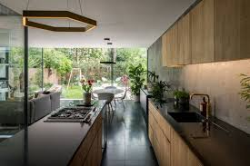 Arranged In An Open Plan With Dark Terrazzo Tiled Flooring The Main Living