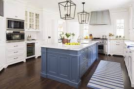 White Kitchen With Dark Wood Floors Box Pendant Lights Over Blue Island