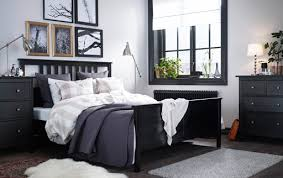 A Large Bedroom With Black Brown Bed Textiles In Beige White