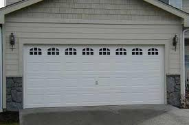 American Overhead Door We install repair or replace broken