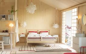 A Medium Sized Bedroom Furnished With Open Floor To Ceiling Storage Consisting Of