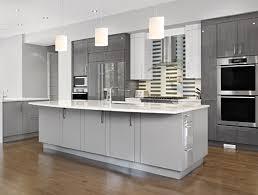 grey kitchen cabinet design with hanging ls and brown floor