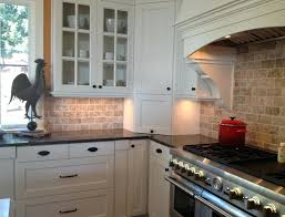 tumbled travertine subway tile backsplash sink faucet kitchen