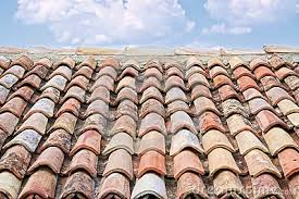 typical clay roof tiles on a building in southern italy antique