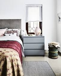a bedroom with gray furniture and bright textiles ikea