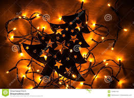 Download Black Christmas Tree On The Wooden Background With Small Yellow Stock Photo