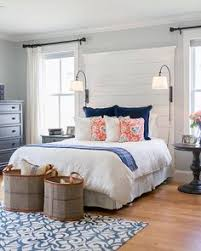 A Quaint Bedroom With Bright Accent Pillows