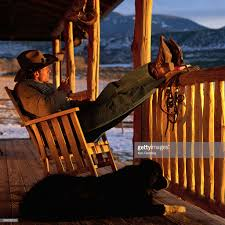 100 Cowboy In Rocking Chair On Front Porch Photo Getty Images