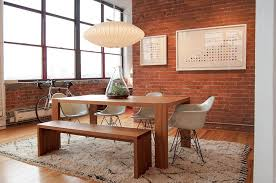 Wooden Varnished Dining Table Long Stool White Armchairs Floor Brick Wall Ufo