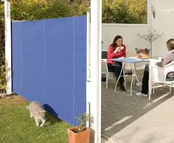 Roll Up Patio Screens by Privacy Wall