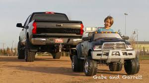 2014 Toyota Tundra Vs Kid Trax Dodge Ram - Tug Of War! - Clip.FAIL