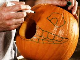 Electric Pumpkin Carving Knife by Halloween Pumpkin Carving A Large Pumpkin Eating A Small Pumpkin