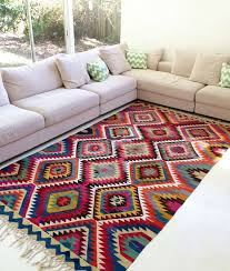 colorful rug with zigzag pattern and fringes for a light