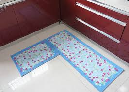 Two Fruit Patterned Decorative Kitchen Floor Mats Over White Porcelain Tile Flooring And Red