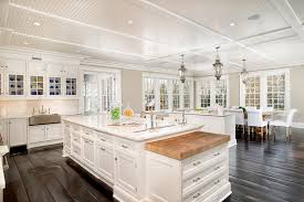 Luxury Kitchen With Calcutta Umber Marble Counter Island