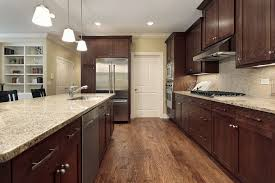 chocolate cabinets with light granite counters savae org