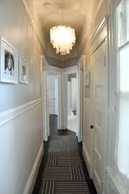 small capiz shell chandelier narrow small hallway painted in white