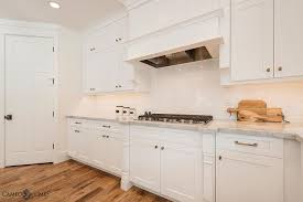 white kitchen cabinets with white subway tiles transitional