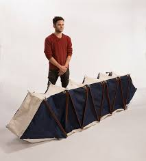 Melina backpack transforms to an accordion like tent