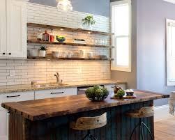 three floating wooden shelves white colonial subway tile