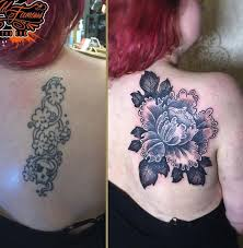 Beautiful Flower N Tribal Tattoo On Lower Back Real Photo