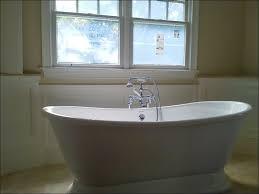 freestanding tub in corner traditional gray tile bathroom idea in