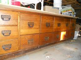 Antique oak seed grain bean counter from a general store in