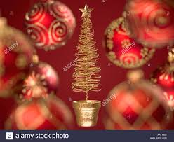 Close Up Of Red Christmas Ornaments And Small Tree